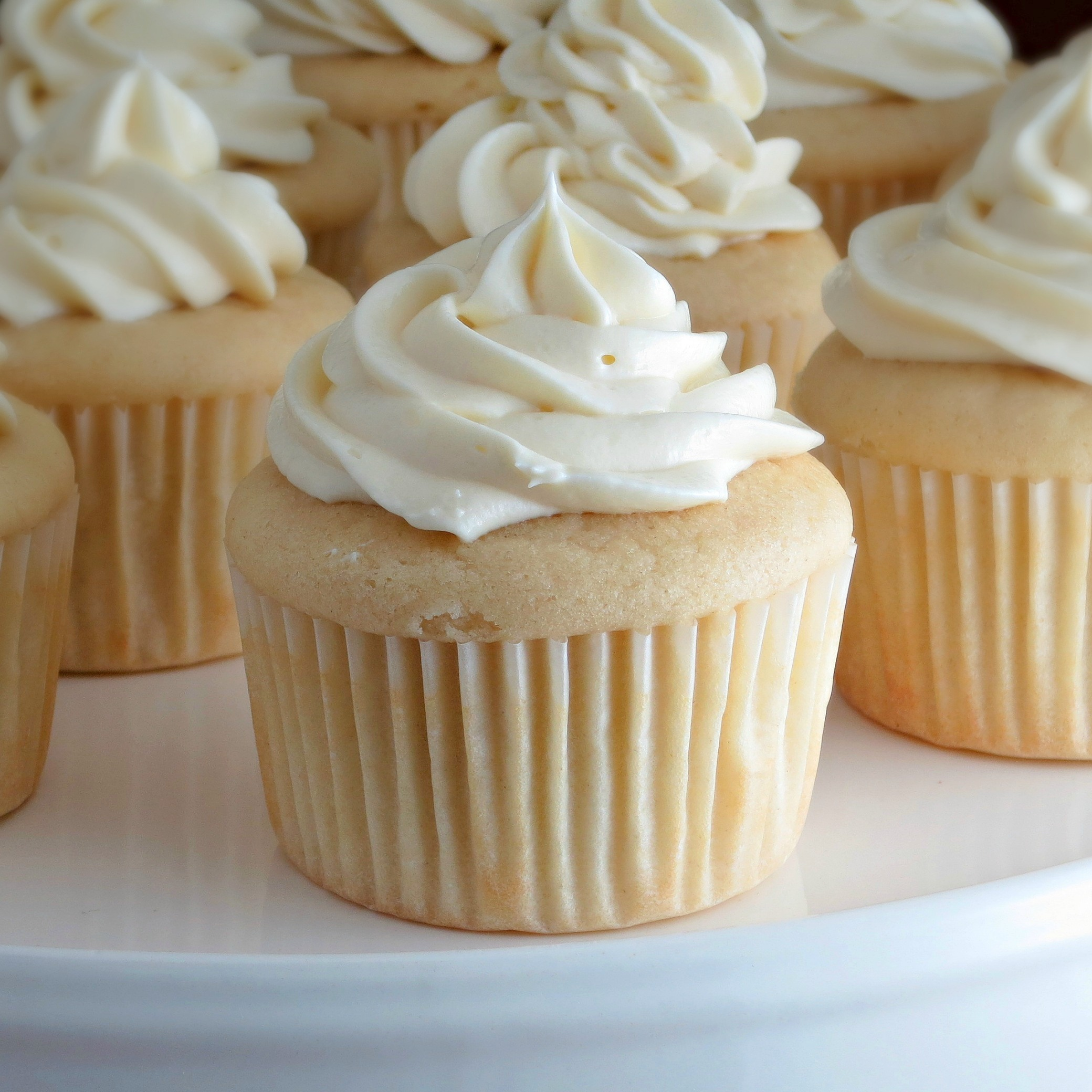 White Cupcakes With Truffle Cream Topping Recipe — Dishmaps